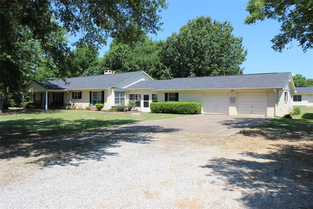 Come see this 3/2 on 13.137 acres in Meadowood Subdivision! The large living area has a pretty brick wood-burning fireplace. The kitchen has updated appliances and a beautiful breakfast nook with lots of natural sunlight. There is a formal dining room just off the kitchen and living area.The master bedroom is huge with a sitting area and a wood burning fireplace. In the master bath, you will find his and her sinks and a nice shower. The two guest bedrooms are spacious and share a nice hall bath. Outside, you will find an abundance of storage space. Between the kitchen and the garage is a large breezeway that leads to the 2-car garage. Behind the house, you will find another two-car garage that also has a good size workshop. Updates to this home include: new vinyl flooring, new plugs and switches, new lighting, new A/C system, new roof on the house and shop, new plumbing fixtures, new counter-tops, new paint throughout, and a new hot water heater. Call us today!