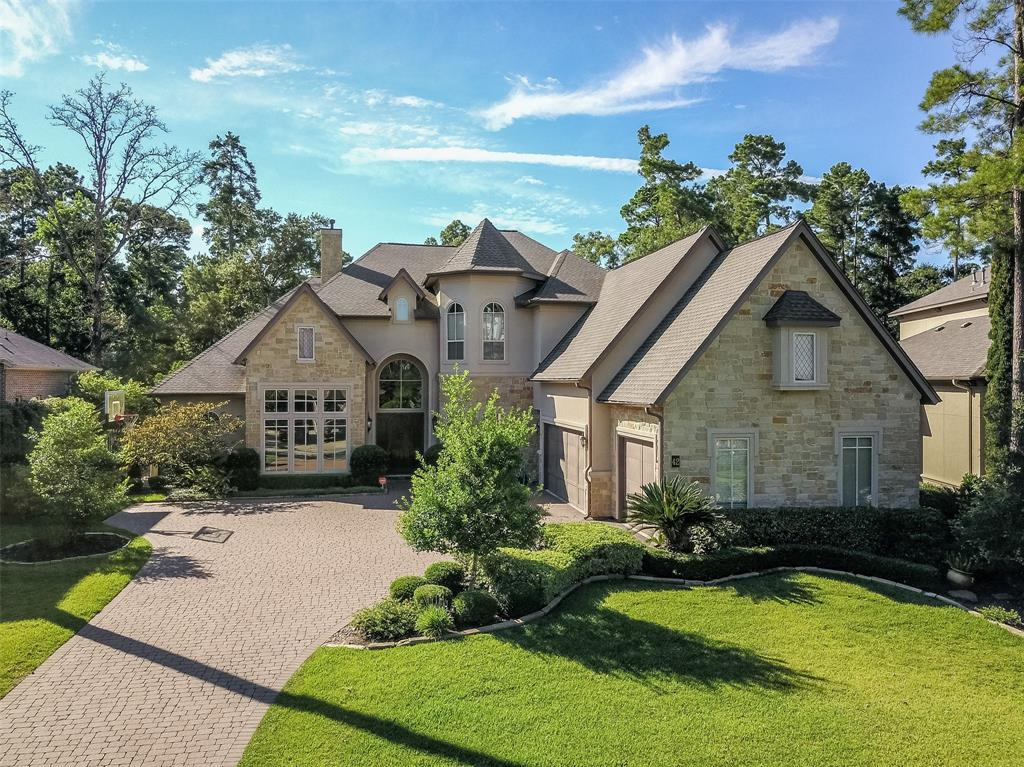 Soaring 24' ceilings in foyer, expansive living spaces & high-end touches are offered in this beautiful custom home.  Freshly PAINTED - Light & Bright! Gourmet kitchen has double ovens, island & breakfast bar, 2 sinks & an abundance of cabinets/counters. A butlers pantry is convenient to formal DR. Huge breakfast room overlooks covered patio w/outdoor fireplace. Large great room has coffered ceiling, hardwoods, built-in, wall of windows/doors overlooking backyard. Master & guest suites on 1st floor. 2 master closets are a bonus. Two staircases & 2 extra rooms for craft room/study-1 down & 1 up. 3 over-sized bedrooms up have en-suite baths. Game room has hardwoods, kitchenette, Juliette balcony & large outdoor balcony overlooking private pool & golf course. Huge Media Room & Extra Room (currently a Music Room). A study nook is upstairs w/ 2 built-in desks. Lots of storage & a TX Basement. Outdoor entertaining highlights a pool/spa, large covered patio with outdoor kit & gas fireplace.