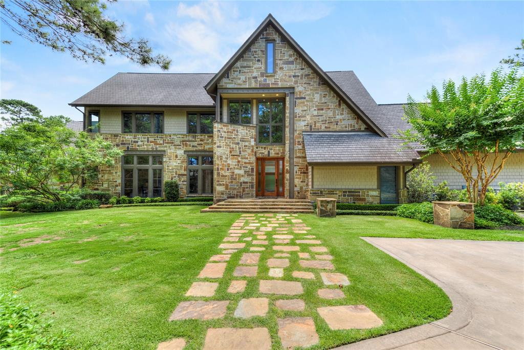Architecturally cool home meticulously built from the ground up, used  finest materials. Stone & wood exterior,  oak flrs down, Brazilian mahogany up. 5 Beds 6.5 baths & a 7 Car garage with car lift. 1st floor  Master plus an additional BR!  Double sided fireplace from living area leads to an executive office then to the primary BR. suite.  Kitchen with fireplace, double islands,Soapstone counters & walk in pantry opens to family room, wall of windows spans the entire back of house. Dual staircases!Large laundry room! Upstairs 3 large bedrooms plus game room 3rd floor media room & office. extra parking plus circular drive!!Private 4 acres means you can have a horse. Huge deck,pool & spa. great for parties & grilling!  22 Kw gas powered backup generator, aerobic septic system & well. be off the grid... 2 structures make up the 7 car garage. 1 3 car garage, then a 2nd building with double high ceilings & stained concrete floors. Cul de sac street!Gated community of Bridle Creek.