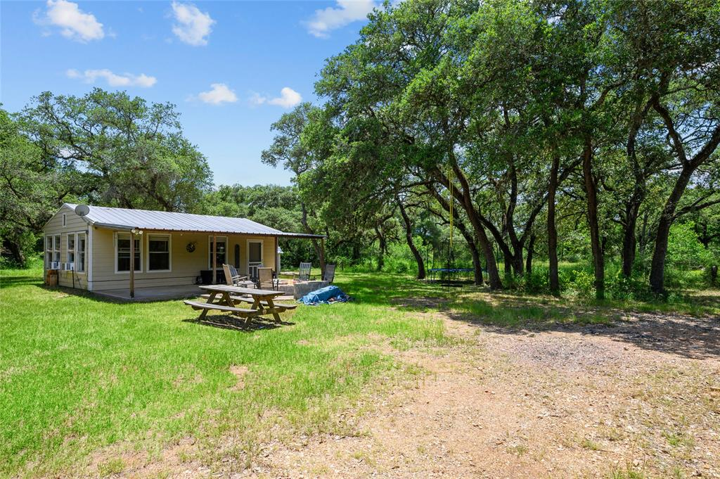 A must see! This very nice 36.11 acre property is conveniently located 3 1/2 miles south of Rock Island where Cr 106 turns into FM 1693. It offers a very nice cabin with a 12x40 concrete covered porch and a 13x16 half moon concrete extension with a fire ring. Also, you will find two barns for storage and a separate electric RV hook-up. This is all nestled under and around large mature live oak trees. This property carries potential for cattle, horses, hunting or just simply recreational. The wildlife you will find are white-tailed deer, hogs, doves, and turkey. The property offers some very nice wooded areas mixed with some nice clearings. Very good mixed for wildlife habitat. At the same time, there is good cover and grazing for livestock. Towards the south end of the property there is a stock pond with a windmill. Ag exempt!