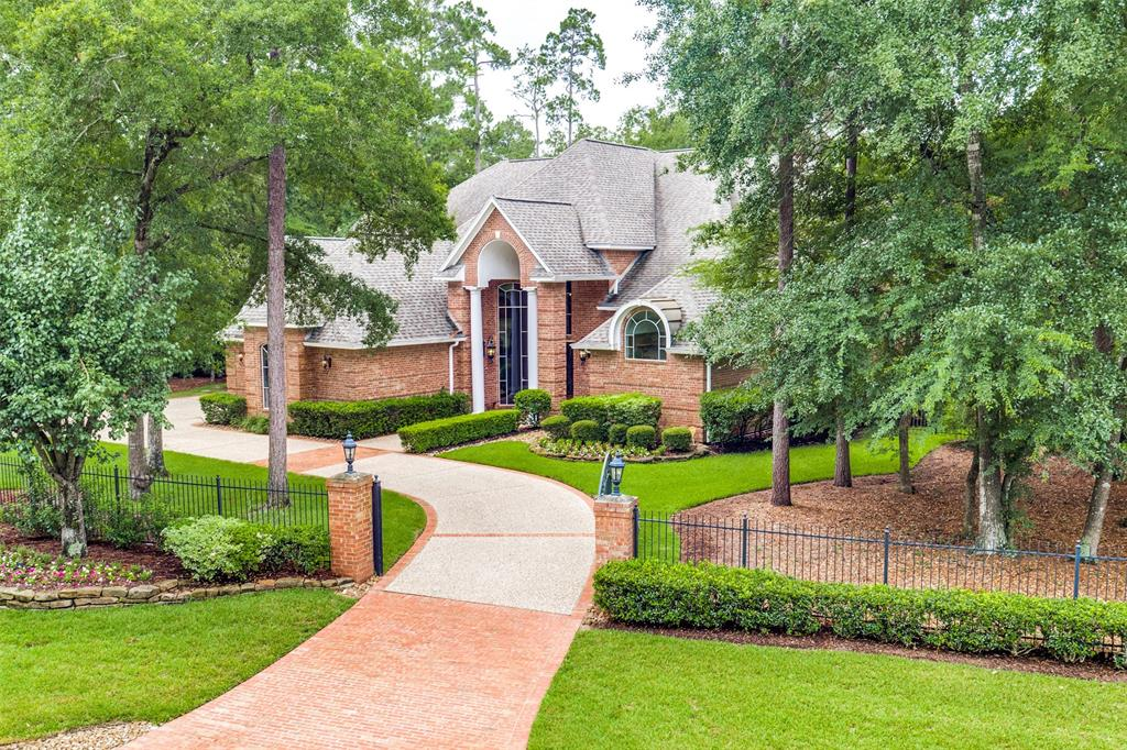 Gorgeous, Custom built home on the Palmer Golf course. This home will take your breath away. As soon as you walk through the front door you will find a grand 2 story entry w/dual staircases, detailed trim work and an abundance of windows with views to your outdoor oasis and The Palmer GC. This home features 5bedroom(2 down), 4.5 bathrooms and 4 car attached garage, gated, circular driveway. Study with french doors, impressive living and dinning room, granite kitchen with stainless appliances and refrigerated wine room. Guest suite downstairs with bath that leads to outdoor living area that is fully equipped w/tv,surround sound and mosquito system. Upstairs you will find 3 bedrooms that are very spacious each with its own walk in closet with custom shelving. Game room, bonus room, storage room and extra study. Don't forget the upstairs balcony too. A perfect combination of Luxury and Comfort.