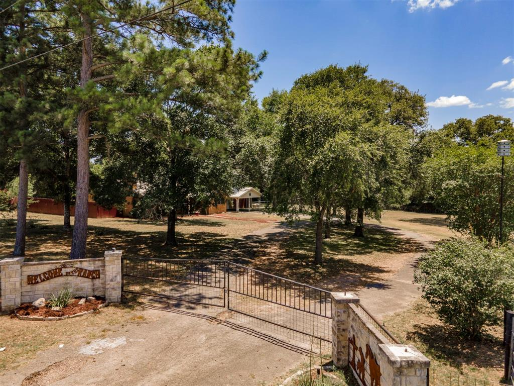 This immaculate 3BR/2BA brick home on 4+ acres is completely fenced and cross fenced and is waiting for you to make it your place to call HOME! Central A/C and heat and remodeled with comfort and easy living in mind. The 2 car garage was converted to a beautiful master suite and is located apart from the remaining bedrooms for privacy. The home offers a separate room which could be utilized in any number of ways. The workshop could be a man cave, she shed or converted inot a barn for animals. The two car carport and large hardwoods offer ocverage and shade for your vehicles. This home has tile in kitchen, bathrooms and dining rooms, wood flooring throughout bedrooms and in the living area with a brick wood burning fireplace. With plenty of room for horses or 4-H/FFA animals, yet small enough to maintain with ease.