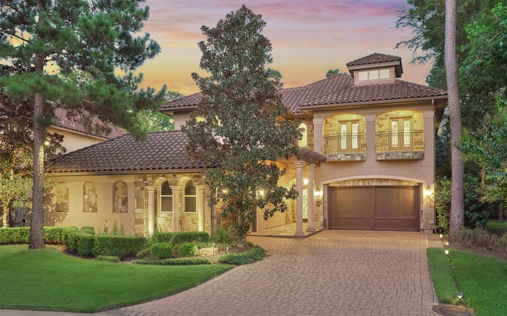 THE ULTIMATE ESSENCE of casual luxury is captured in solid construction, superior flow & function, exceptional maintenance, and idyllic location in gated Carlton Woods golf community! Extraordinary opportunity in value w/superior features + turn-key readiness! Over $250K renovation in '16 by original builder for quality & consistency, including beamed ceiling, stunning fireplace surround w/tumbled stone, added living area, extended year-round, outdoor living + upgraded finishes! Fresh interior paint! New HVAC systems in '17 & '19 + pool equipment! Timeless Travertine/hardwoods, gourmet kitchen opens to main liv area, secluded master suite w/enviable closet + adjacent sitting rm/library/wine rm, dedicated study! Game/media room with wet bar, spacious en suite bedrooms + bonus living area upstairs! Panoramic/butted windows overlooking backyard oasis w/mature landscaping, saltwater lap pool & spa, summer kitchen & outdoor fireplace! Zoned to exemplary schools! High & dry, low tax rate!