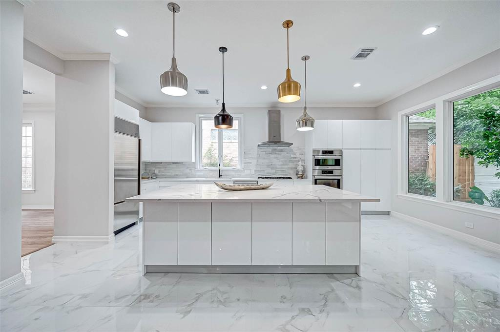 """Stunning Renovated Home in the Middle of Houston Uptown/ Tanglewood. Come see the beautiful """"2020 Design"""" Open Floor Concept , Hardwood Floor through out, Top of the line quality Quarts counter tops, amazing kitchen cabinets with special features and new Bosch appliances. Family room has new sound system installed. Primary Bedroom features an En- Suite Luxury bathroom, a study/ office, and a coffee/wine bar with sink and new refrigerator. Secondary Baths feature suspended cabinets with under-mounted lighting and Quarts counter top. Third floor could be transformed into a home Gym, Sewing /Quilting room/ Game room/ Man Cave etc,,,, Home is Elevator ready!! Back Patio is unusually large for the neighborhood and has out door speakers. (Grass is in process of being installed)There are large trees creating a nestling effect. The community has a Pool and a Doggie Park. Come make this house your home in the city. Close to all Major Freeway, Medical Center, Down Town , and Galleria."""