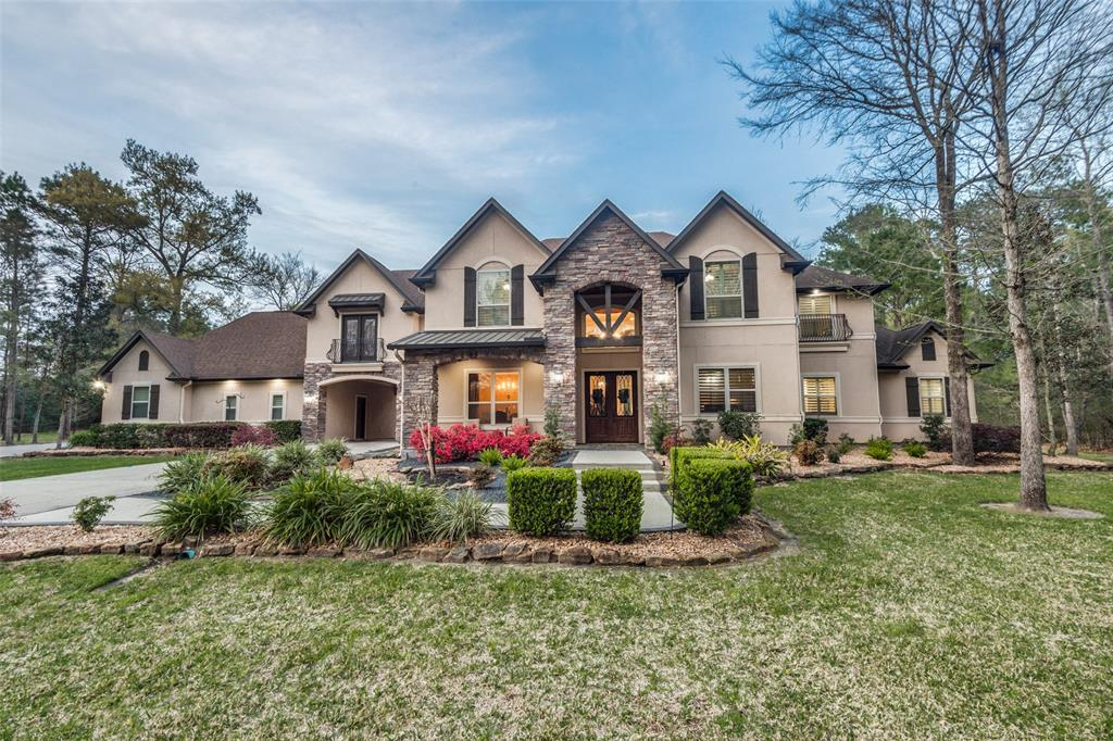 Stunning custom home on 7.515 acres surrounded by beautiful hardwoods.  Travertine floors, gourmet kitchen with commercial style appliances. Huge patio with fireplace and outdoor kitchen. Media room with projector and screen included. Custom draperies, plantation shutters, faux painting. Master suite has walk-in shower, granite, fireplace behind jetted tub, separate dressing areas with built ins, huge closet and exercise/flex room. All bathrooms have granite counter tops.  Study with wood beamed ceiling and wood floors. Buyer should verify all room measurements. Security Entrance gate, built in auto switching Kohler propane generator, water softener, home surge protector. New Roof installed on 6/18/2020
