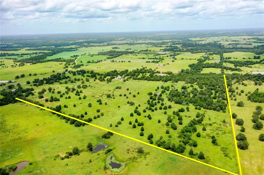 Rare find between Paige and Lincoln! Gorgeous rolling acreage with ponds, trees, clearings and views within an hour of Austin and College Station, only 24 minutes to Bastrop. Perfect for your beautiful new country homesite! Ag exempt for low taxes, county water available at street, electricity on adjacent properties, septic needed. Restricted against mobile and manufactured homes; ask for details about seller-imposed restrictions.