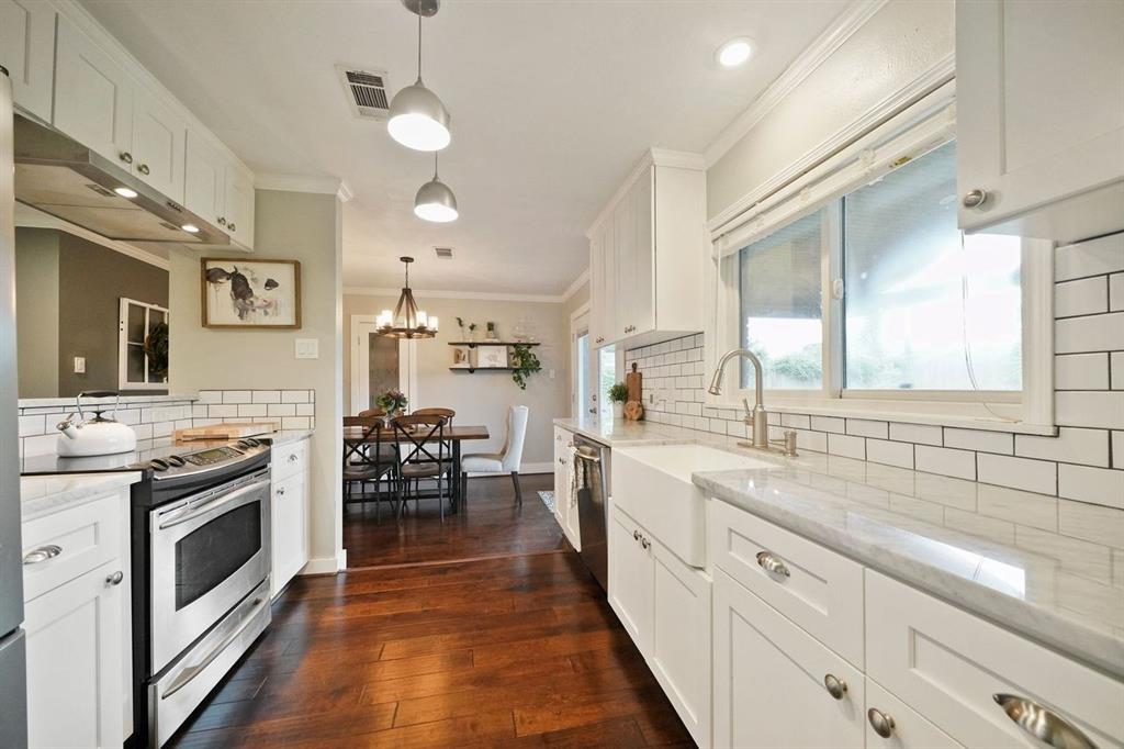 Notice the farmhouse sink and plenty of counter space!