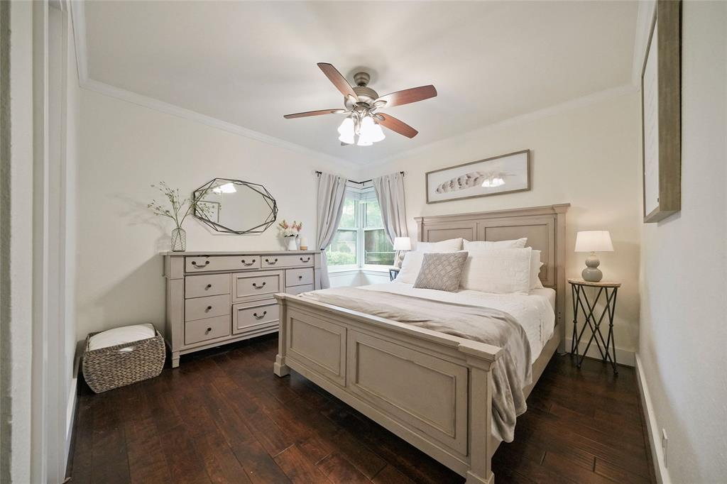Primary bedroom with beautiful trim and wood floors.