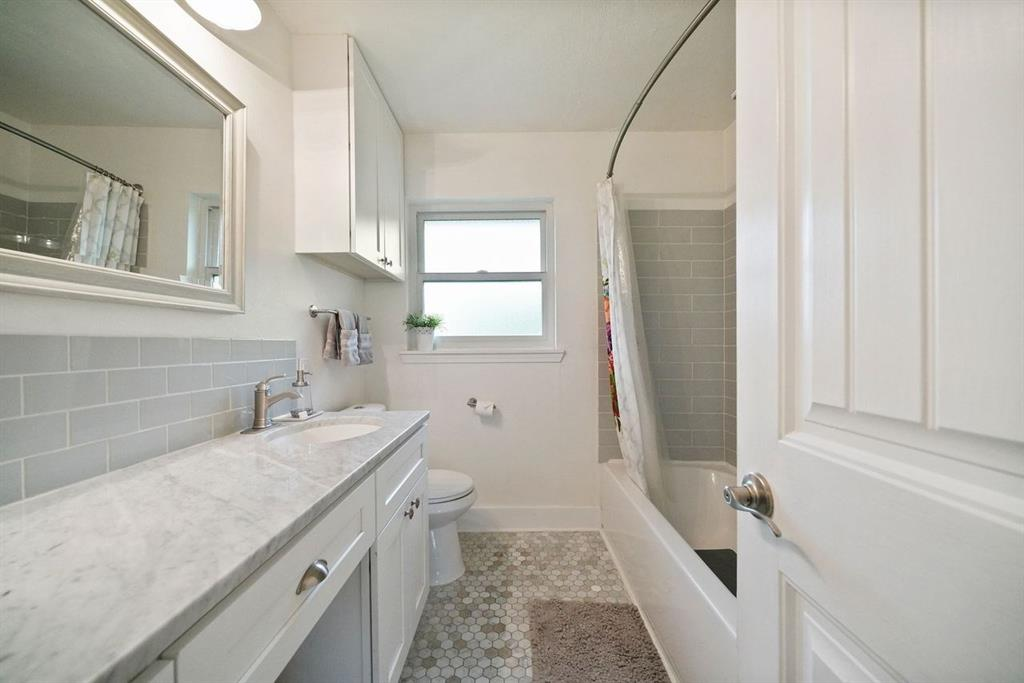 Beautiful bathroom with updated counter top and flooring.