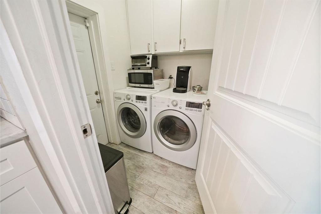 In-home utility room that opens to the backyard.