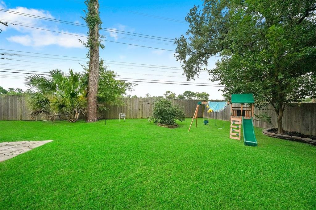 This large backyard is big enough for a pool and would still provide plenty of green space.