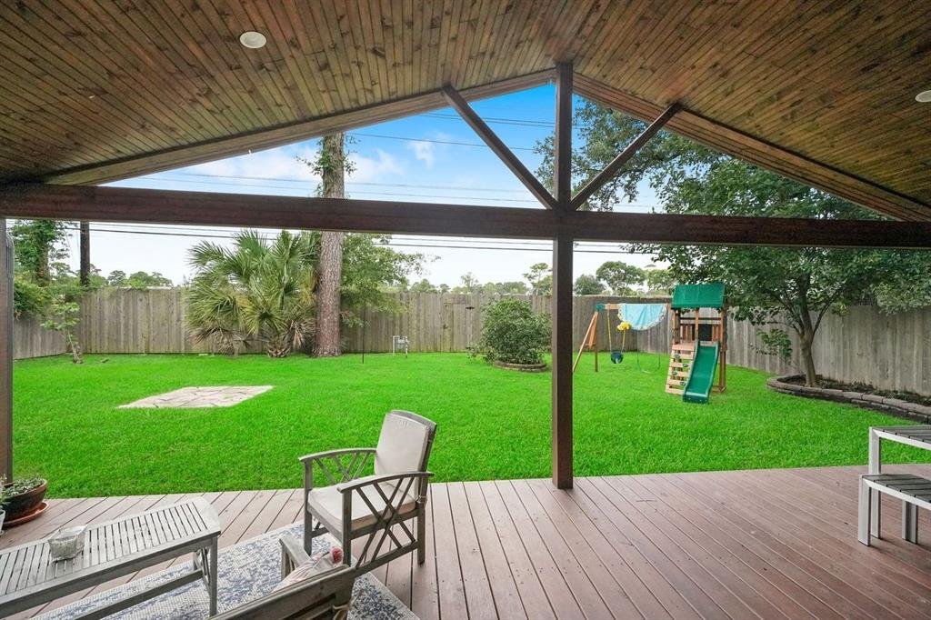 Enjoy the spacious outdoor covered deck/patio that opens to the luscious green yard.