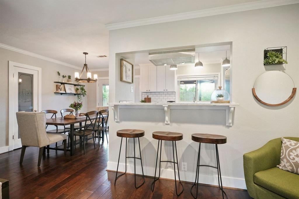 This home features a breakfast bar overlooking the kitchen.