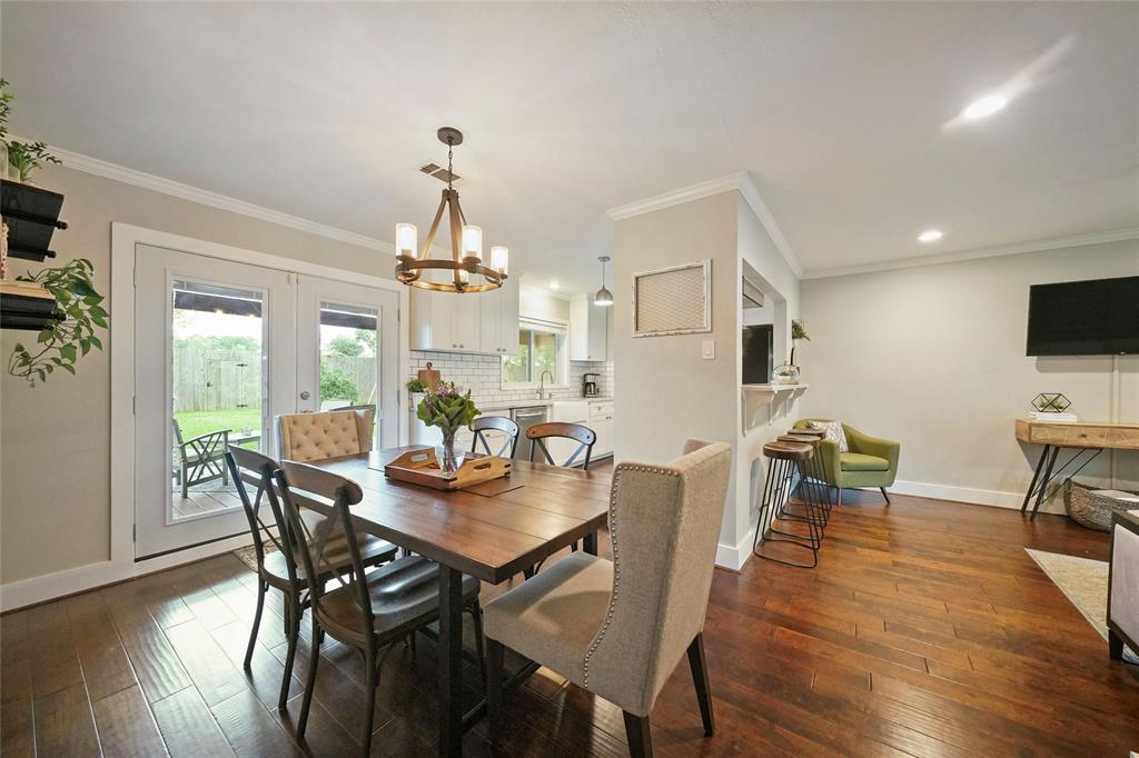 The natural flow of the dining room into the living room provides the open feel you're looking for.