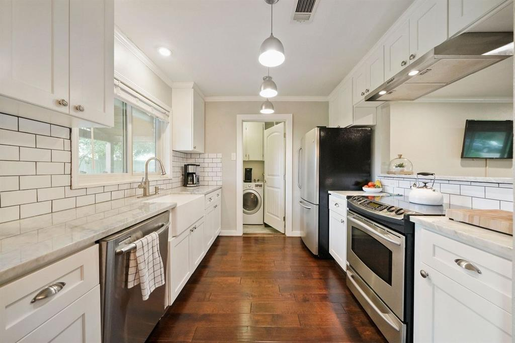 This updated kitchen has beautiful subway tiles, granite counter tops, and SS appliances.