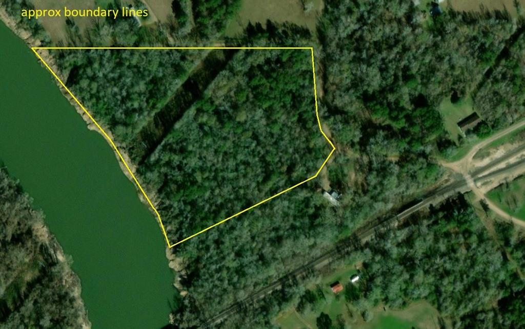This 14.9 acre tract is located in Hardin ISD and is unrestricted with lots of river frontage! This property offers the epitome of privacy and seclusion, being heavily wooded and located off of a rural county road. There is a dollar store, post office, and gas station less than 5 minutes away for quick shopping!