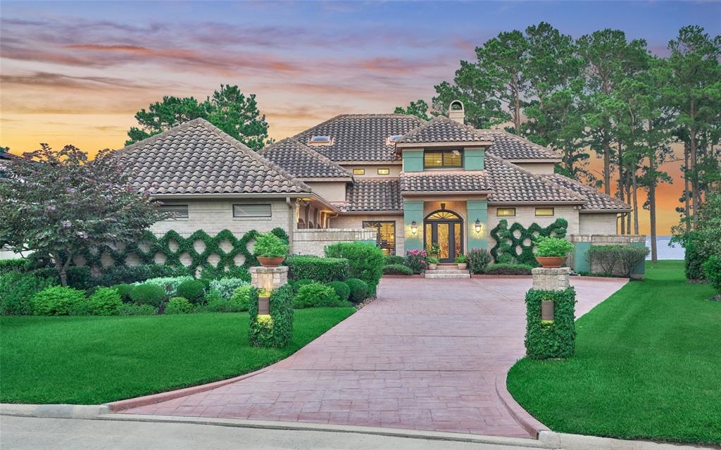 Elegant waterfront home with panoramic OPEN WATER views from almost all rooms.  Timeless style with tasteful updating both inside and out.  Dream gourmet kitchen with commercial style appliances, granite counter tops, custom island with solid pecan parquetry counter tops, cedar beams, and water views!  Shiplap, stone, cedar, and natural wood throughout the home adds distinctive style.  Two bedrooms down.  Gameroom with wet bar up.  Spacious master suite has updated bath with OVERSIZED baja shower and jetted tub.  Extensive covered outdoor living areas overlooking the lake both upstairs and down. Custom saltwater pool.  Patterned concrete drive.  Generous outdoor lighting.  Lush professional landscaping. PREFERRED EASTERN EXPOSURE!
