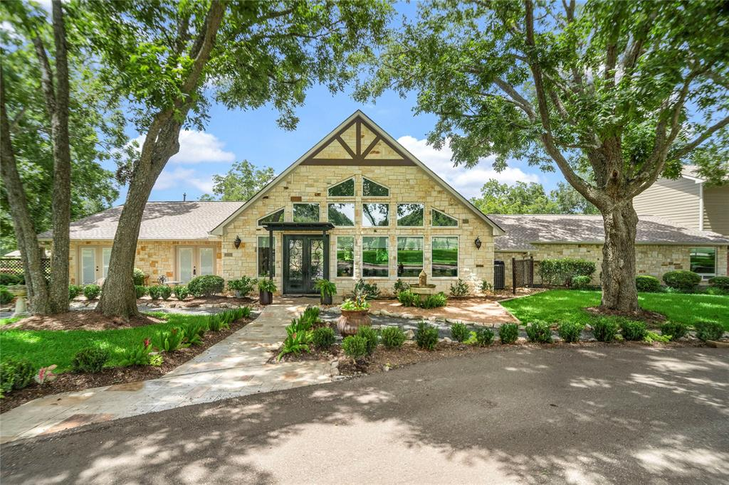 A distinctive country estate with everything needed for a work at home, educate at home, relax at home lifestyle! Nestled on 6 breathtaking wooded acres, artfully designed during a stud-up remodel in 2014. Elegantly faced with 60 tons of hand-cut Hill Country limestone featuring a great room with towering ceiling, chef's kitchen, wine room, barreled and coffered ceilings, imported travertine and wood flooring. This architectural masterpiece boasts a large detached versatile flex space with expansive windows to take in the serene views. With a full bath, day kitchen, living area, and two private rooms currently used as home offices.  Work from home and conduct virtual learning away from distractions, with plenty of room to spread out for exercise or virtual meetings. A quiet space for your morning coffee, your business calls, and your evening workout – you won't find a space like this married to a one of a kind home sanctuary anywhere else! Reserve your private tour today!