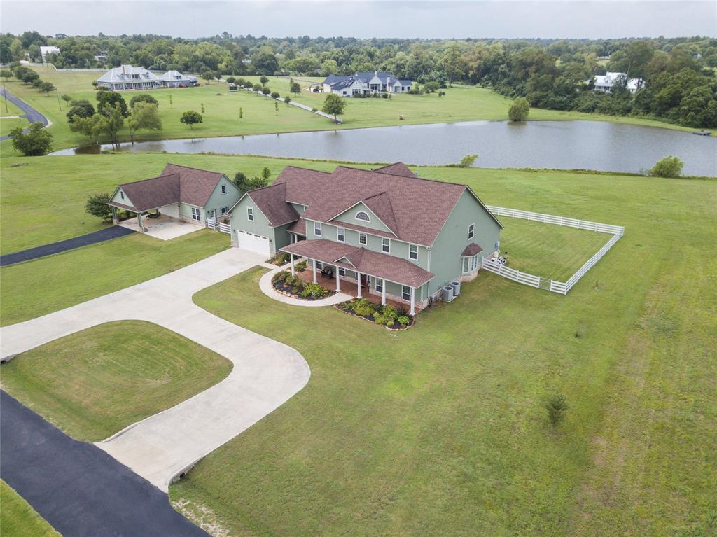 5400 sqft home on 4.5 acres on pond located in gated community, walking distance to historic Montgomery, detached gar w 400 sqft flex rm pool/spa overlooks pond, 5-6 bdrm, 4 full bth 2 half, study, large utility rm, master down, opt 2nd bdrm down, game rm, central vacuum, 2 tankless water heaters, remarkable front/back covered porches,  Large Master suite, claw ft tub/over sized shower, Extra flex rm down, could be office/bdrm/workout/craft/sun w/full bthrm.  Up 4 bdrm & gamerm, 1 bdrm possible private suite w/own staircase & full bth, Attached over sized 2 car garage w/epoxy floor, vacuum system for car detailing.  Large storage space 36x15 unfinished ducted for AC for future use.  Won't find a house w/more storage in home. Kitchen hosts 2 dishwashers, pot filler, butlers pantry, toaster/appliance hide-a-way, double oven and large island perfect for entertaining.  Detached 2 car garage, covered parking w/AC finished 400 sqft flex space w/full bath, horse allowed & much more