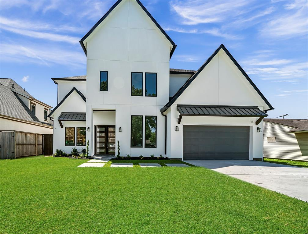 """BRAND NEW CONSTRUCTION. Construction has just been finished by end of April 2020. Texas Living Homes is bringing you this beautiful custom home built by Elevated Custom Homes. Gorgeous 4 beds, 3-1/2 bath, oversized 2 car garage, 4015 sq.ft. living area with modern design. Open concept with large windows and tons of designer upgrades throughout, such as: - Beautiful double entry doors - Double height 23 Ft ceilings in foyer, study, and living areas - Designer kitchen - High end master bathroom finishes - Fibrex high quality finish Andersen windows - 12 ft high ceilings throughout first floor - 8 ft double panel doors throughout - 6"""" baseboards - Engineered wood flooring - Game room & media room additions - Home media pre-wire, camera system pre-wire, & security system pre-wire   Easy access to Katy Fwy. & 610. Close to Galleria, Ikea, Walmart, Marq'E Entertainment Center, Memorial park, and major restaurants. Free Thermador fridge if buyer can close by end of August 2020."""