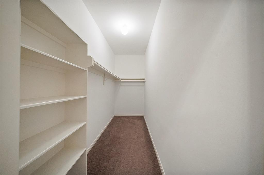 Huge walk in closet for guest suite on the ground floor.