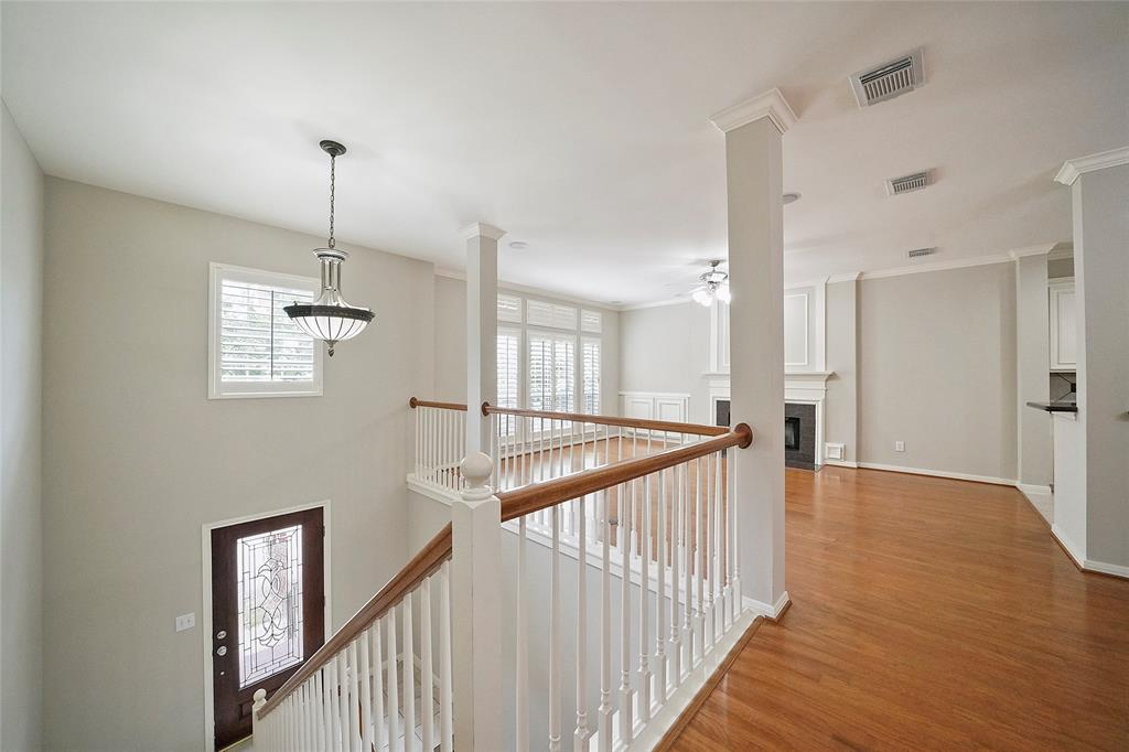 Living space from top of stairs. Open plan living. Bright with high ceilings.