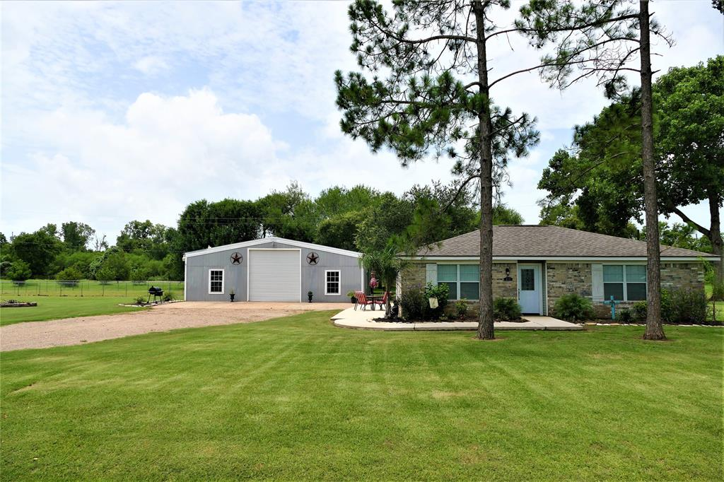Experience Country Living and spread out, just 20 minutes West of Katy!  1.4394 Acres w/ mature trees and a large fenced in Kennel area that could be a safe yard for small children.  Tastefully updated home w/ porcelain tile flooring throughout, soft close kitchen cabinets, built in buffet, all surfaces are granite. The MOST amazing barn is approx. 36 X 48 w/ a resurfaced ceiling in 2018, Hardi-board siding, plumbing for a small kitchen in the barn, as there was once a small apartment in there, 3rd bathroom with shower is wheel chair accessible in the barn, also an amazing workshop that has a meat smoker in the corner and AC window unit, a friendly bar to share stories of laughter and love, room enough to park your RV in this barn with plenty of room to spare, with an electric roller door to close. New well in 2020, aerobic septic installed in 2015, hot water heater in the barn and home.