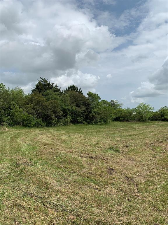 A beautiful 2 acre tract of land is cleared and ready for your country home.  Build your traditional single-family, a barndominium or use for agriculture.  With 160' of road frontage, this property has plenty of access from historical Vacek Rd.  The elevation of this land is premium since it is not in a flood zone!  This property is within the Santa Fe ISD boundaries but outside the city limits.  Electricity is available nearby but well and septic would need to be added. Deed restrictions prevent the use of this land for mobile homes.