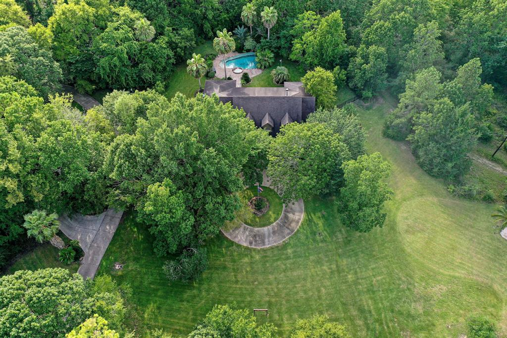 Wow!  Are you ready to purchase your own private family compound within minutes of Lake Conroe and Downtown Montgomery?  This is THE PLACE!   Builder Owned/Built Paradise!  Comes with a Primary Home, a Guest House and a third property/Office/Living Quarters & Huge (39x32) Workshop.  Primary Home has over-sized 3 Car Garage, lovely rock swimming pool and spa, huge entertainment patio/outdoor kitchen w/fireplace and a full bathroom.  You will have all the privacy you want with your own par 3 practice hole golf area with sand traps and your 1/2 acre pond!!  Property is made up of two tax records for a total of 11.866 +/- ACRES.