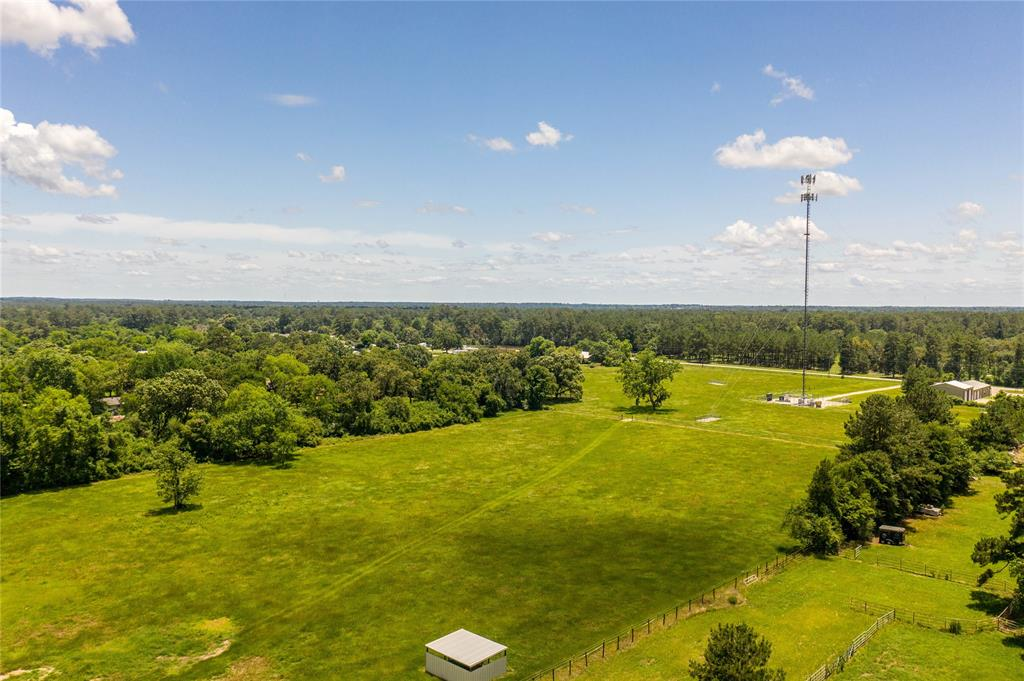 This 7+ acres has income from the cell tower and frontage on Nichols Sawmill for your business.  Amazing area and close to Houston and Houston Oaks. More acreage available.