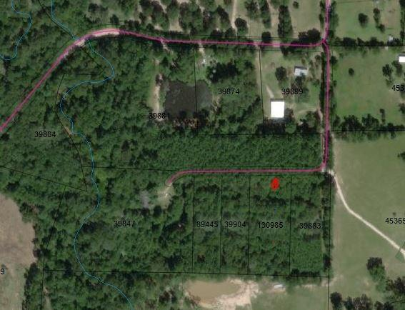 A small acreage (2.094 acres)  tract located in the Southern part of San Jacinto Co.  This parcel is heavily wooded with the beauty of the East Texas forest, large pine and hardwood trees.  A great place to locate your weekend getaway or that primary home.  Minutes to the Coldspring, the county seat of San Jacinto.  Locate near Double Lake Recreation and the Lone Star Trail, Sam Houston National Forest.  Only 15 minutes from U59, make this tract attractive to living in the country, but having city conveniences just minute away. Come see today!