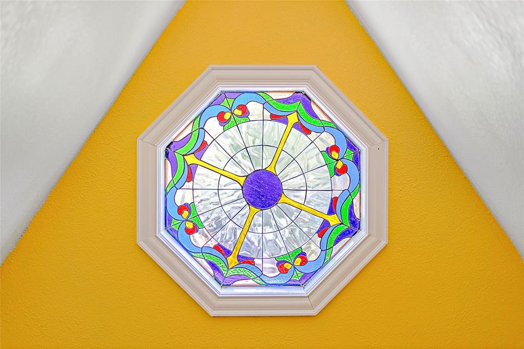 Octagonal stained glass provides warm natural light.