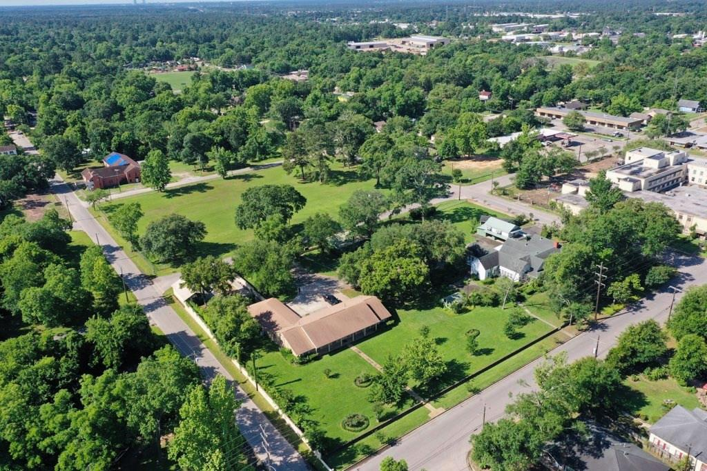 Wow! Welcome to one of the most unique properties in all of Downtown Conroe. Originally the Hooper Estate, but previously used by Buckner Family Services as office space. This sprawling estate was established and built by Dr. and Mrs. W.N. Hooper in 1894. Since 1894, the property has undergone many additions and improvements. It currently houses a 3,793 sqft home built in 1972, the original home with 5,508 sqft (includes garage apartment), and many other buildings. The land the homes sit on encompass the whole block, which equals a little over 3 acres. The neighboring block on the other side of E Avenue G is also for sale, for $400k. It is 2 acres. This land can be zoned and used in many manners (commercial, residential, multi-family, etc.), and we welcome you to reach out to the City of Conroe's City Planner's office for more information. Feel free to walk the exterior of this land, but call for any on grounds visits. We welcome all serious offers and buyers. Please self-verify data.