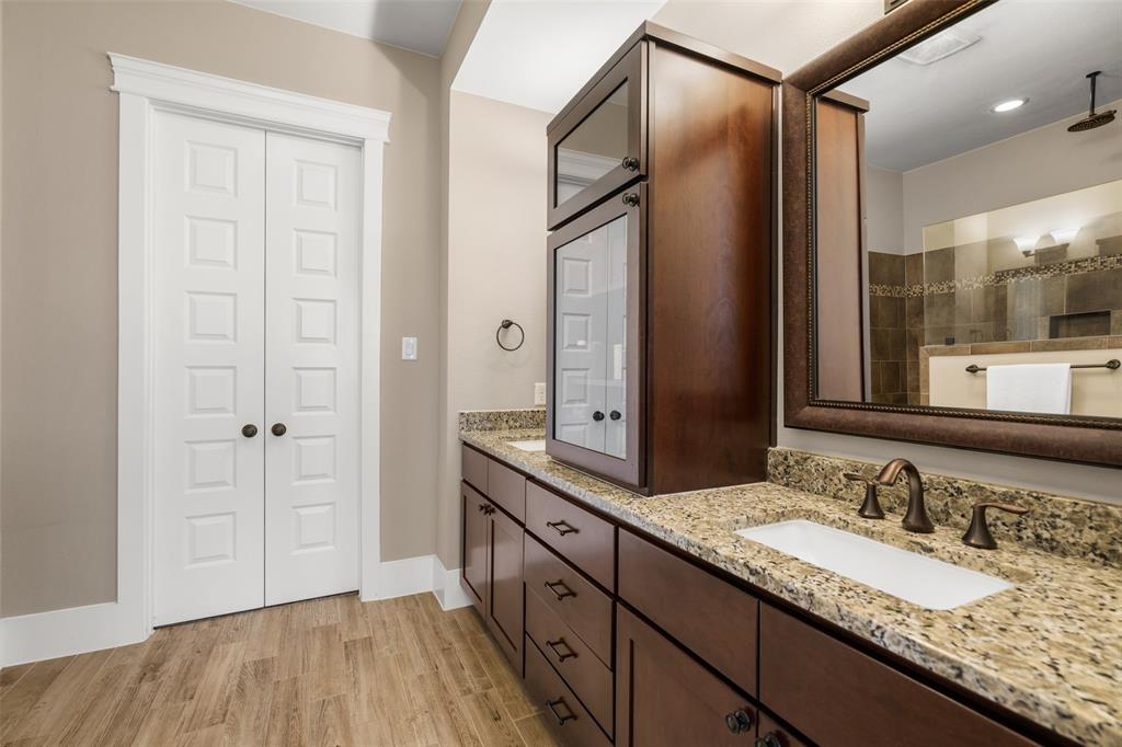 The master bath features dual vanities and lots of storage.
