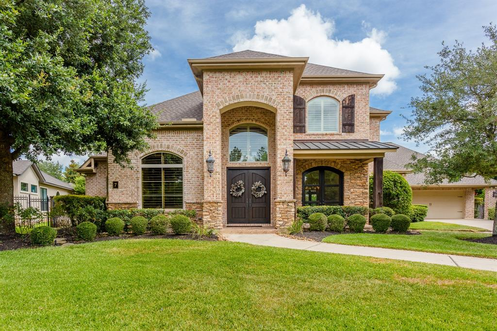 Absolutely stunning brick & stone George Weaver custom home on oversized cul-de-sac lot in Seasons Trace. Beautifully maintained classic beauty is filled w/impeccable finishes such as cathedral ceiling & gorgeous wood beams, brick accents, recently refinished American Black Walnut wide plank hardwoods, brand new (never lived on) carpet in bedrooms, Plantation shutters throughout & large 1st floor primary suite! Spacious kitchen w/high-end stainless appliances including Sub Zero refrigerator, breakfast bar & center island opens to light-filled family & breakfast room. Other features include NEW ROOF (2020), 3 secondary bedrooms (each w/private en suite bath), ample storage throughout, gameroom & large media room w/surround sound & wet bar accessed by separate staircase! The backyard is a breathtaking, private oasis w/meticulously maintained pool and spa plus covered patio w/summer kitchen, stone fireplace & ceiling heaters. This gorgeous home is in excellent condition and move-in ready!