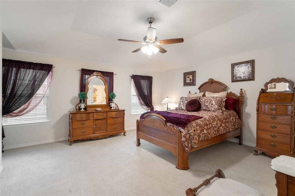 The over-sized primary suite with large walk-in closet features new interior paint and new ceiling fan.