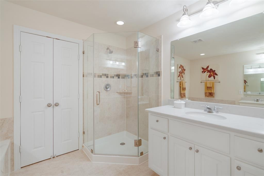 The primary bath also has a beautiful shower with updated glass enclosure.