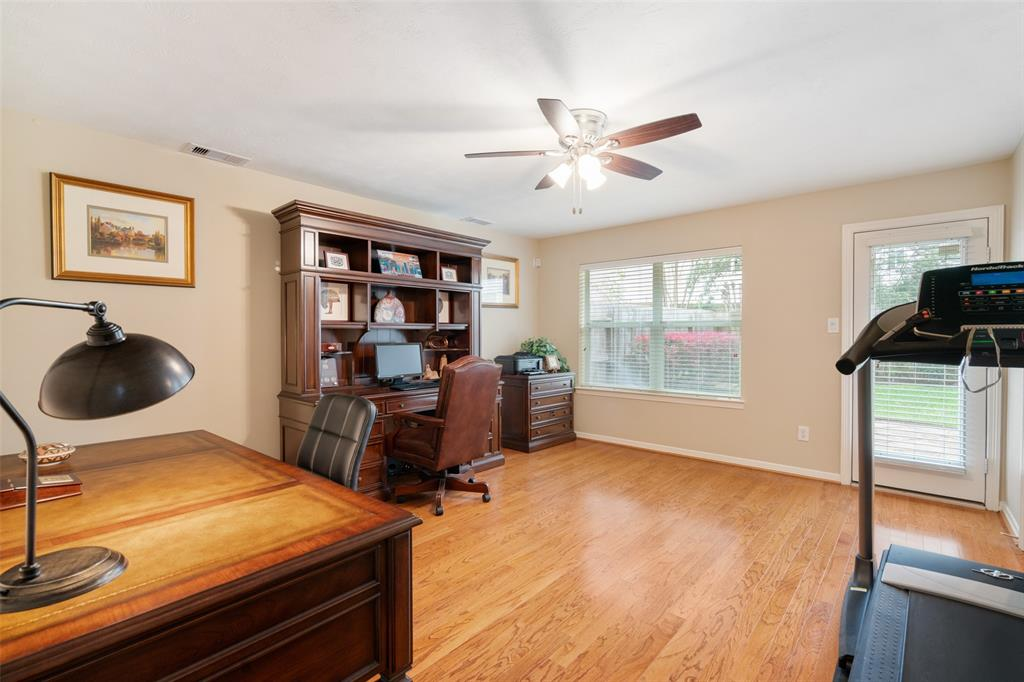 Spacious first floor bedroom with wood floors and access to the back yard and patio.