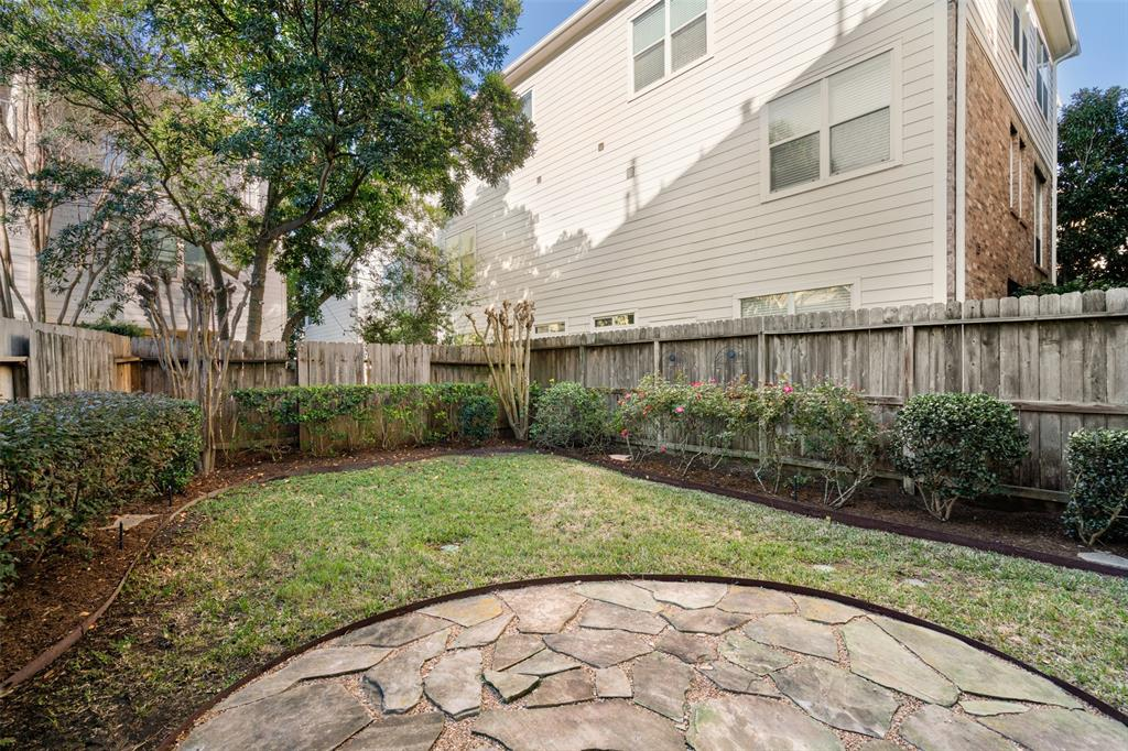 Large, fully fenced back yard and patio is perfect for the family dog and entertaining.