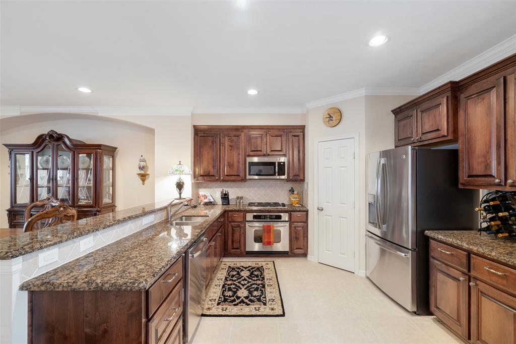 The kitchen features granite counter tops, lots of storage and stainless steel appliances.
