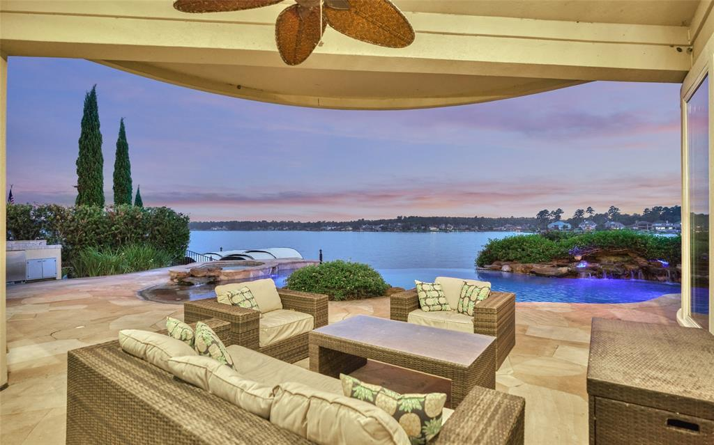 Beautiful waterfront with vast views of Lake Conroe and a fabulous infinity pool w/ beach entry/waterfall & spa and many updates! 2+ car Air Cond. garage w/golf cart bay, large outdoor covered entertaining area w/fireplace. Reinforced cement bulkhead, Updated ACs (2016), Roof updated (2012), Boat dock w/boat slip & 2 jet ski lift/cover/Equipment updated (2018), Three baths completely remodeled, Remodeled kitchen w/ new granite/cabinets/hardware & $35k in high-end appliances (Sub-Zero fridge, BOSCH dishwasher, Wolf gas stove) & 2 pantries! Updated exterior doors & windows, updated carpet & paint. Soaring 2 story ceilings, rich trim work, open living room w/ amazing wet bar, plantation shutters, Lutron lighting, 2 sitting areas w/ sweeping lake views. Pool bath, spacious owners retreat & large secondary BRs. Enjoy life like you're on vacation w/ access to the country club, THREE 18-hole championship golf courses,the yacht club, sports club, and 24 hr manned gate. Golf Memb available.