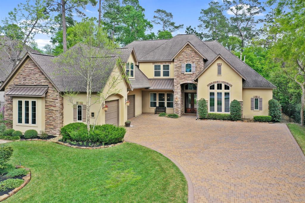 This stunning custom home is situated on the 7th hole of the The Woodlands Country Club Gary Player Course! This beautifully designed home has great architectural interest and details throughout including- Vaulted Living room, two spacious oversized back porches, wood floors and travertine tile and built-ins galore! The open concept kitchen with island, breakfast bar, granite counters, walk-in pantry overlooks a light-filled breakfast nook and living room with wood beam ceiling, walls of windows and a cozy fireplace. The Master retreat, second bedroom and gorgeous study is downstairs, and the Flex Room/Gameroom, 3 bedrooms and 3 bathrooms up. The over 20,000 square foot lot with lush landscaping features a putting green, pool, spa and spectacular lanai. Enjoy your screened in porch with fireplace and summer kitchen or your patio right off of the pool!