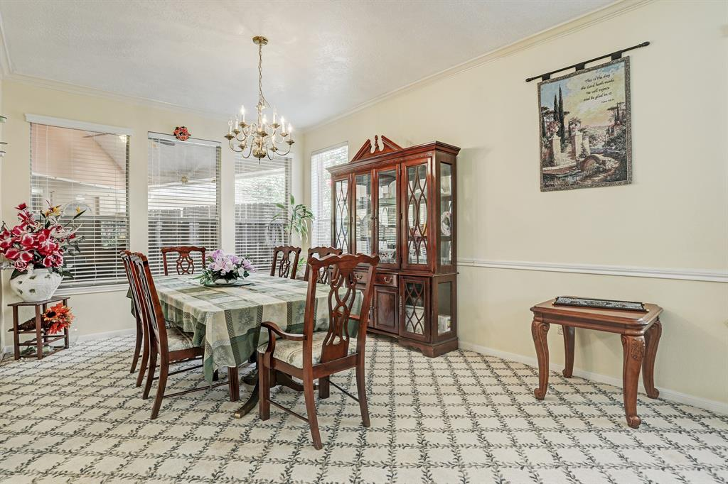 Formal dining room overlooking back patio
