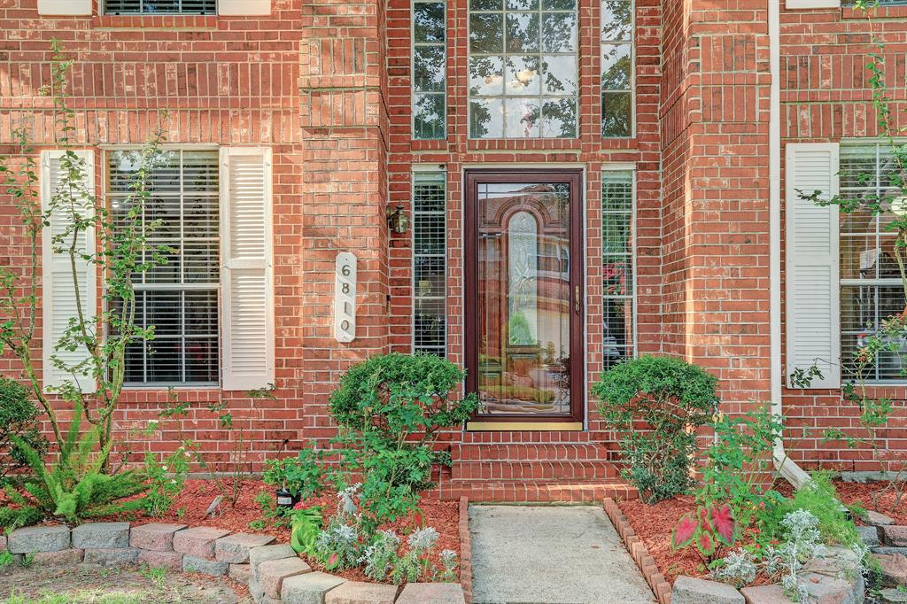 Windows surround the entry way for a welcoming entrance.