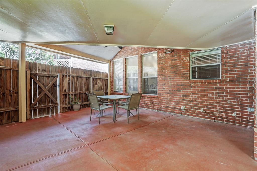 Spacious covered patio perfect for large gatherings and shade from the summer heat or rainy days.