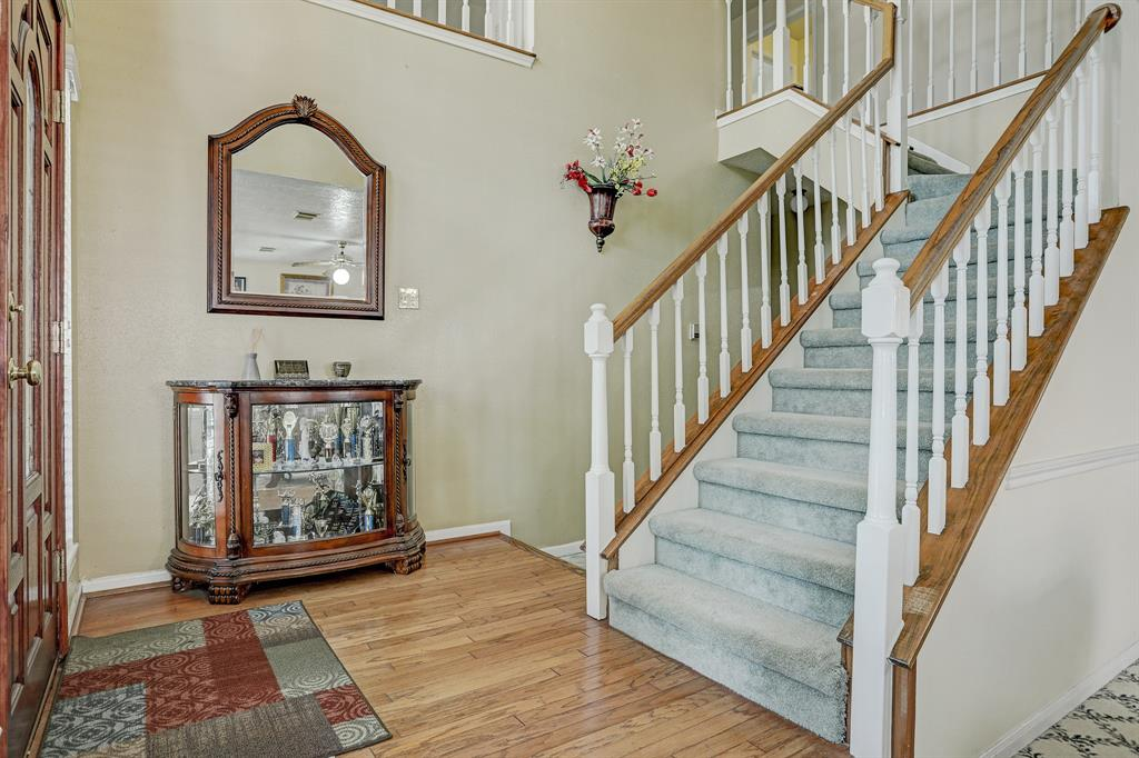 Staircase at main entry leading to 2nd floor.