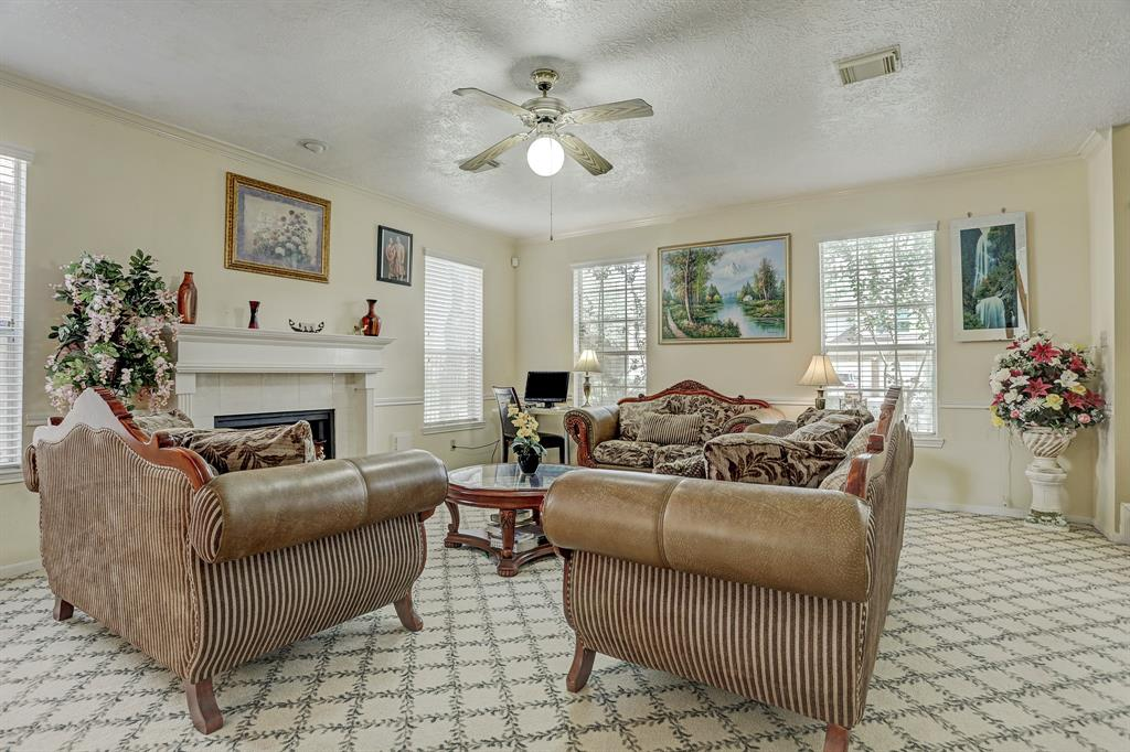 Another view of the family room facing the front of the house, with fireplace.