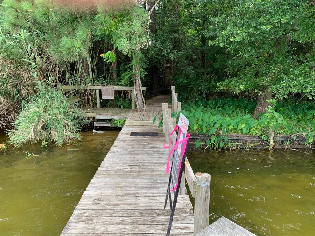 One of the only undeveloped  waterfront parcels  along Marina Drive. Excellent investment or development acreage.  Public water available.  The clean well maintained home is being used for a weekend getaway.  Being marketed as commercial.
