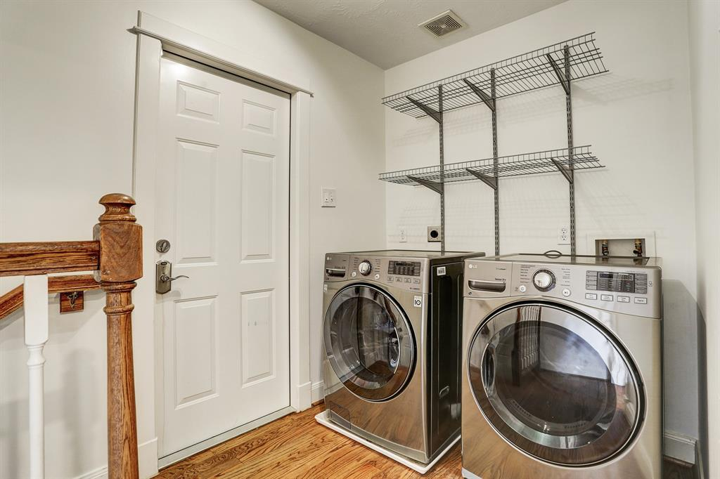 Laundry room off the breakfast room with entry and exit to garage and backyard.