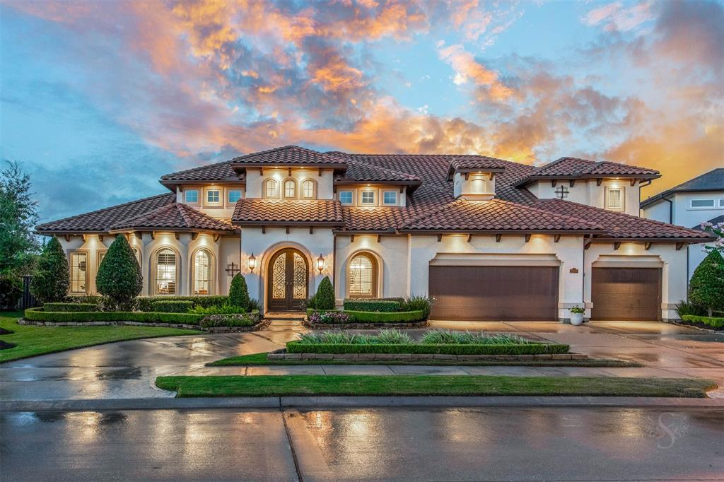 Stunning architecture paired w exquisite finishes & attention to every detail is evident in this truly unique custom home in gated Ironwood Estates in Cinco Ranch. Entertaining will be a breeze w game & media rooms down +gameroom up, a huge island kit w Viking appliances, large wet bar w 2 tap Kegerator & 2 wine/beverage frigs, sep wine room & 900 square feet covered outdoor living space overlooking a sparkling pool/spa on a premium lot w no back neighbors for tranquility & privacy. Fully automated & wired w Lutron Lighting, 8 zone builtin Nuvo Audio & full perimeter HD closed circuit camera system that is all controlled by phone or Ipad, Tile Roof, 3 fireplaces, endless amounts of custom cabinetry & built ins, gorgeous study + another office so you can both work from home, his/hers mas closets, designer chandeliers, wood beamed ceilings, butted glass windows, circle drive & custom cabinetry w epoxied flooring in garage are just a few of the many design elements present in this home!!!
